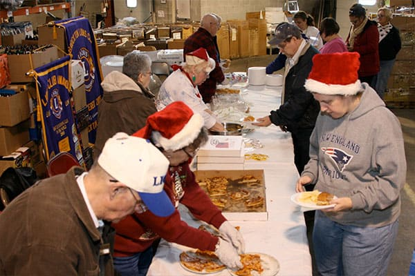 BAArc Christmas Party Lions serving food.