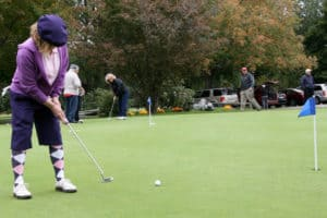 Golfer on practice putting green.