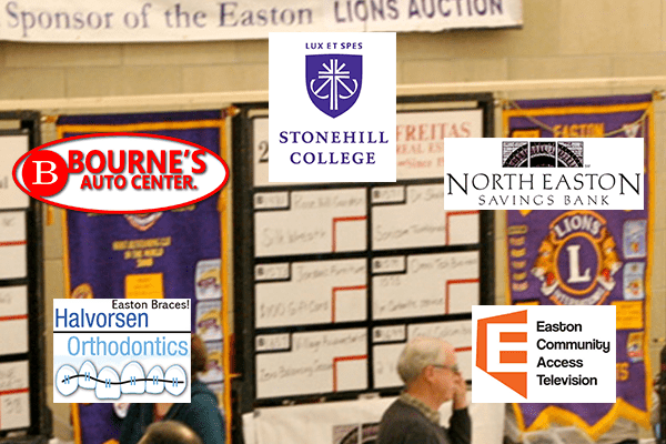 Background auction B-board with Lions banners.