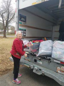 Loading truck to go to YMCA d'Haiti