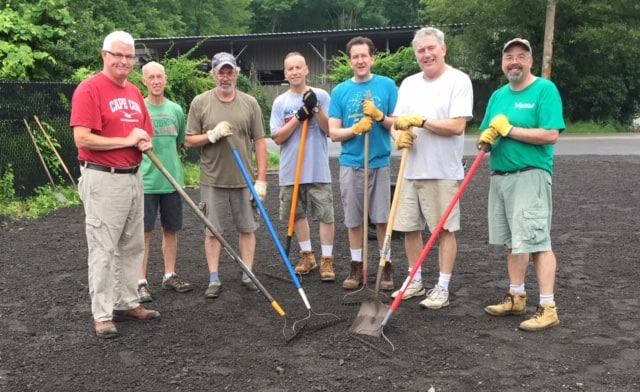 Easton Lions repair the Thrift Store driveway.