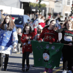 Easton Lions Holiday Festival Parade 2015 kids walking with ugly sweater contest