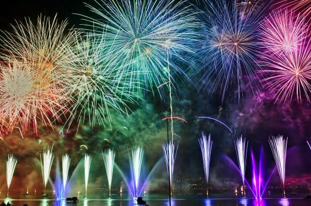 Color fireworks and firetowers on lake