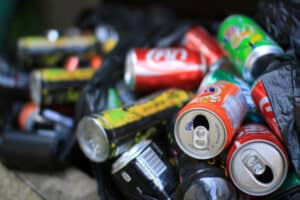 Pile of soda cans ready for deposit return.