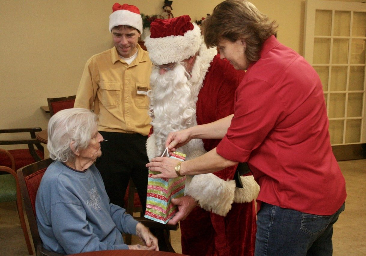 Sants for Seniors delivering gifts.