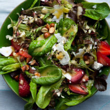 Baby lettuce strawberry salad with feta and almonds