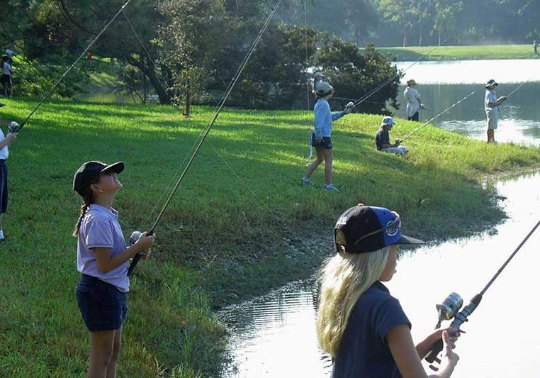 Fishing Derby with kids at a pond